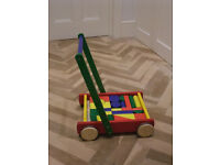 Wooden baby walker trolley with 24 coloured bricks