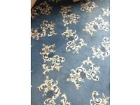 Vintage retro blue patterned carpet with underlay