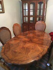 Dining Table, 6 Chairs & Buffet Hutch for sale. Table has 2 leaf extensions. Excellent condition.