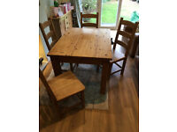 farmhouse style solid wood dining table with 4 solid wood chairs
