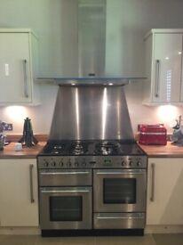 Rangemaster Toledo 1100 Dual Fuel cooker, cooker hood and stainless steel splashback