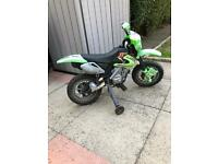 Boys electric motor bike with stabilizers