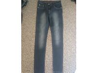 3 pairs of jeans and skirt sizes 8-10