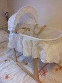 Moses basket with rocking frame, 5 white fitted sheets and duvet.
