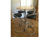 Modern tall round table and 4 high stools