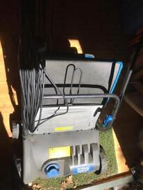 Electric raker and scarifier leaf collector rake