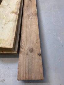 2 x brown 4.8 metre long 150 x 38 timber