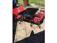 Garden table and 6 red chairs