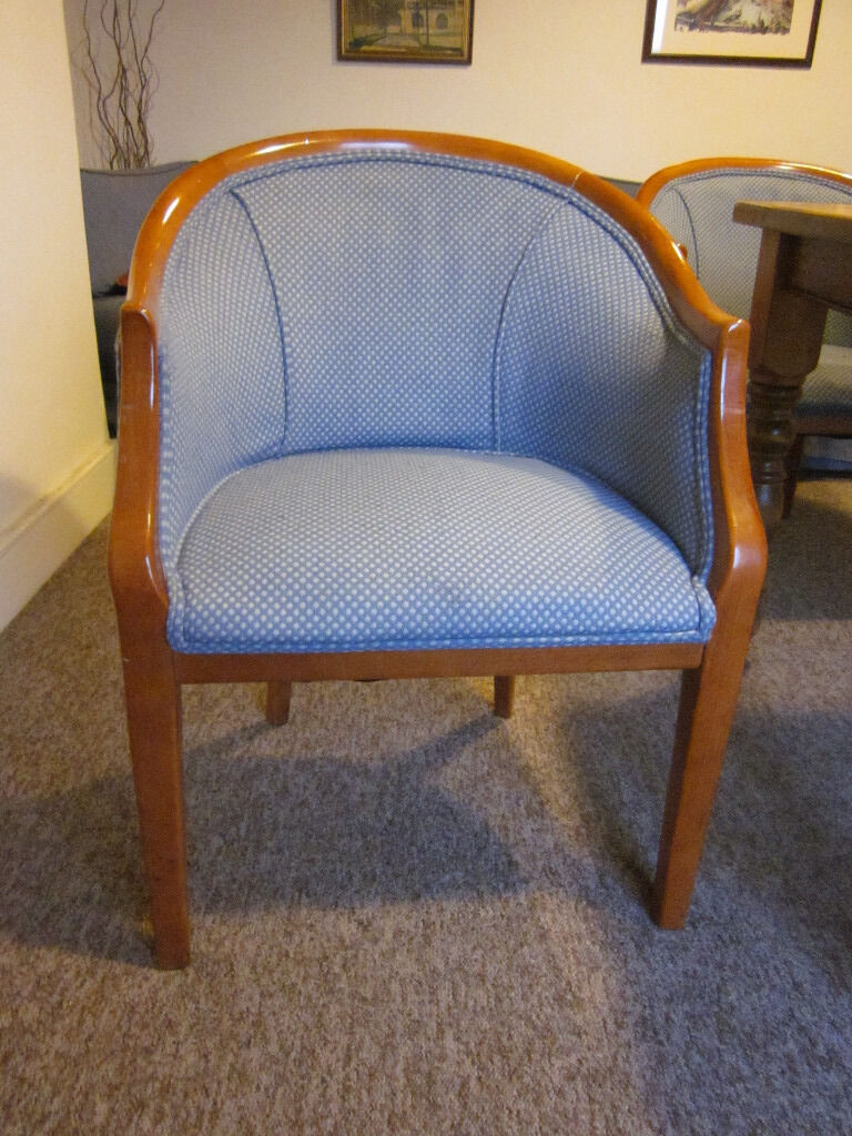 Armchairs, wood frame, grey blue upholsteryin Cambridge, CambridgeshireGumtree - Armchairs, tub type. Mahogany colour solid wood frame. Fabric is greyish blue with small regular pattern in cream. 9 chairs available but happy to sell singly. Price £10 per chair. Dimensions W60 cm x D60 cm x H83 cm