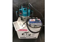 New Makita RP2301FCX 110v 1/2in Variable Speed Plunge Router complete with new box of router bits