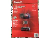 Snap on head torch