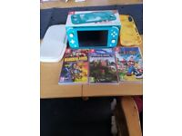 nintendo switch lite . 3 games . carry case