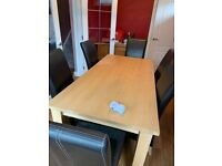 Light Oak Finish Dining Table and Leather Chairs