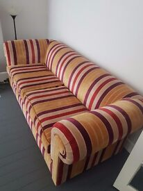 Striped red gold and purple sofa