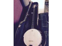 Ozark 5 string Banjo with hard case.