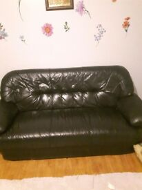 Leather sofa for free, well used but still good for someone in nead.