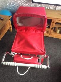 Red silvercross dolls pram