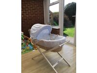 Blue Mamas and Papas Moses basket with white stand
