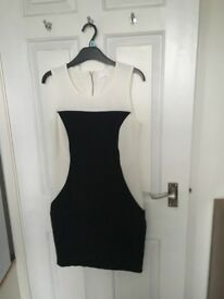 Brand new black and white illusion dress. Size 10/12