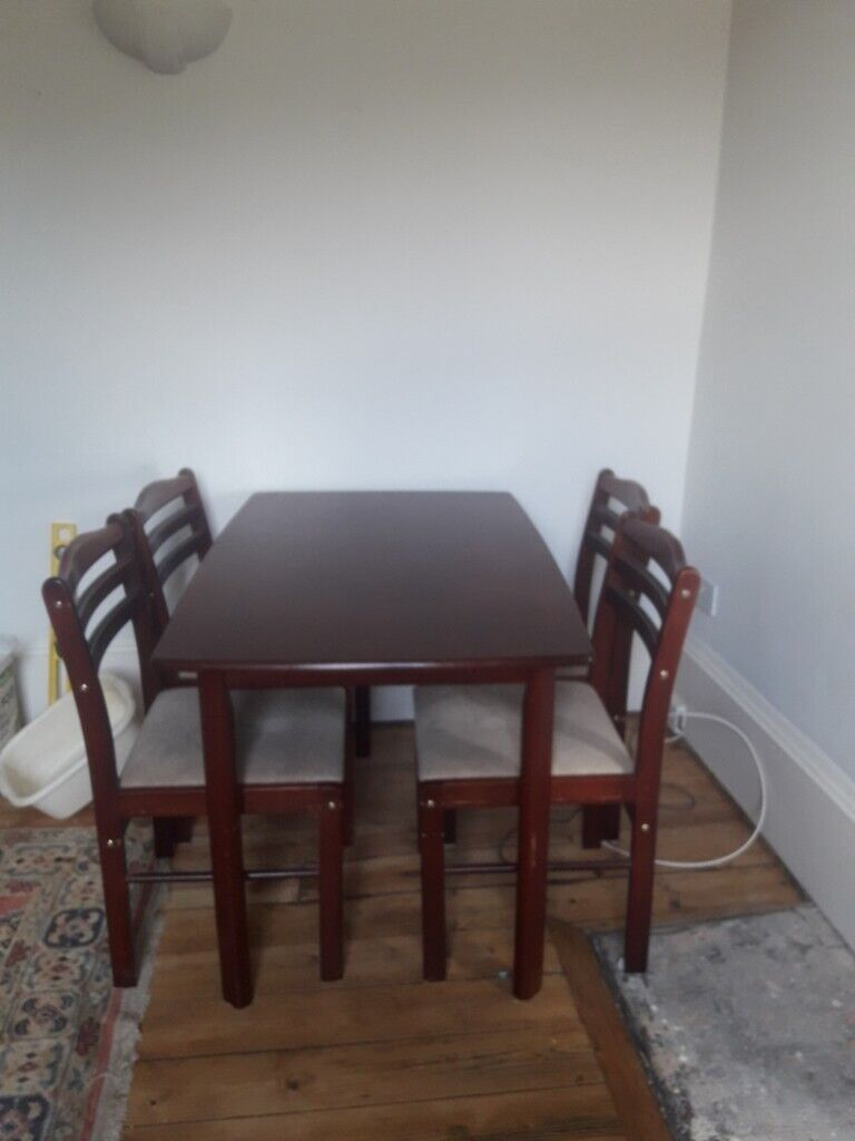Dining table and 9 chairs   in Kirkintilloch, Glasgow   Gumtree
