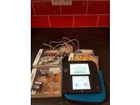 For sale we have a blue and black 2ds comes with charger, case and 4 games