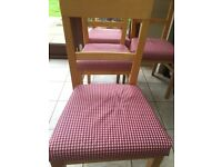 4 second hand pine chairs with washable / replaceable covers.