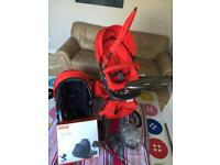 RED STOKKE PUSCHAIR EXCELLENT CONDITION