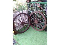 2 large wagon wheels