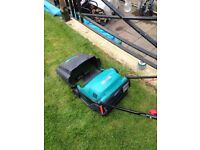 Bosh lawnmower like new