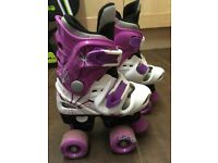 Osprey adjustable size quad skates x 2