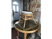 Round conservatory/ kitchen table four chairs bamboo or cane ?? Glass top good condition