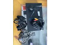 Play station 2 console with two controller with games (Tekken 5, FIFA 2003, GTA 3)