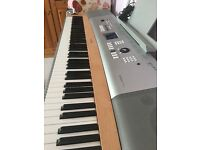 Used piano very good condition, electric