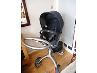 stokke xplory stroller with rain cover fly net covers and cup holder and more