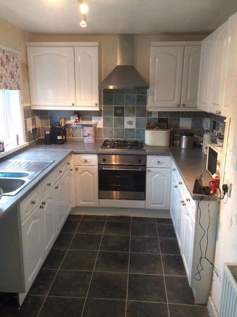 White kitchen units and work tops