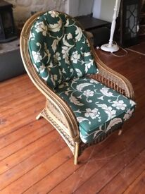 Wicker chair with cushions.