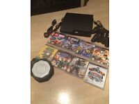 PlayStation 3 inc. 2 controllers and various games for sale