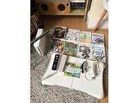 Wii with balance board and games extra controller