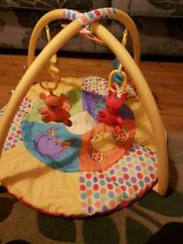 Lovely baby gym in excellent condition with hanging toys