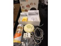 Medela swing breast pump with a brand new bottle