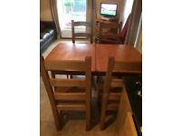 4 solid oak chairs and wooden extendable table - £150
