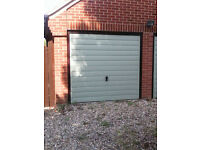 Two up and over metal garage doors in excellent condition.