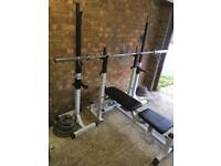 Olympic home gym with bars weights and treadmill