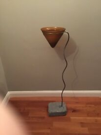 Floating candle bowl on metal stand with concrete base