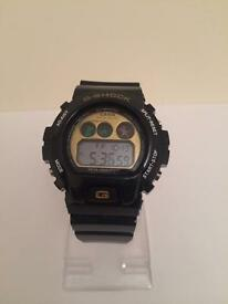 Casio G Shock DW6900 Digital Wristwatch (gold/black)
