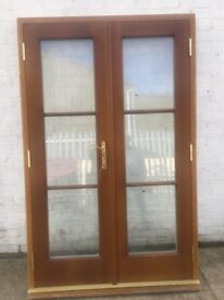 High quality Oak French Doors with Frame Cost new £4000 ( 128 cm w x 201 cm h)