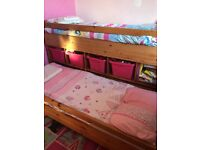 Children's pine bed with storage and pull out guest bed