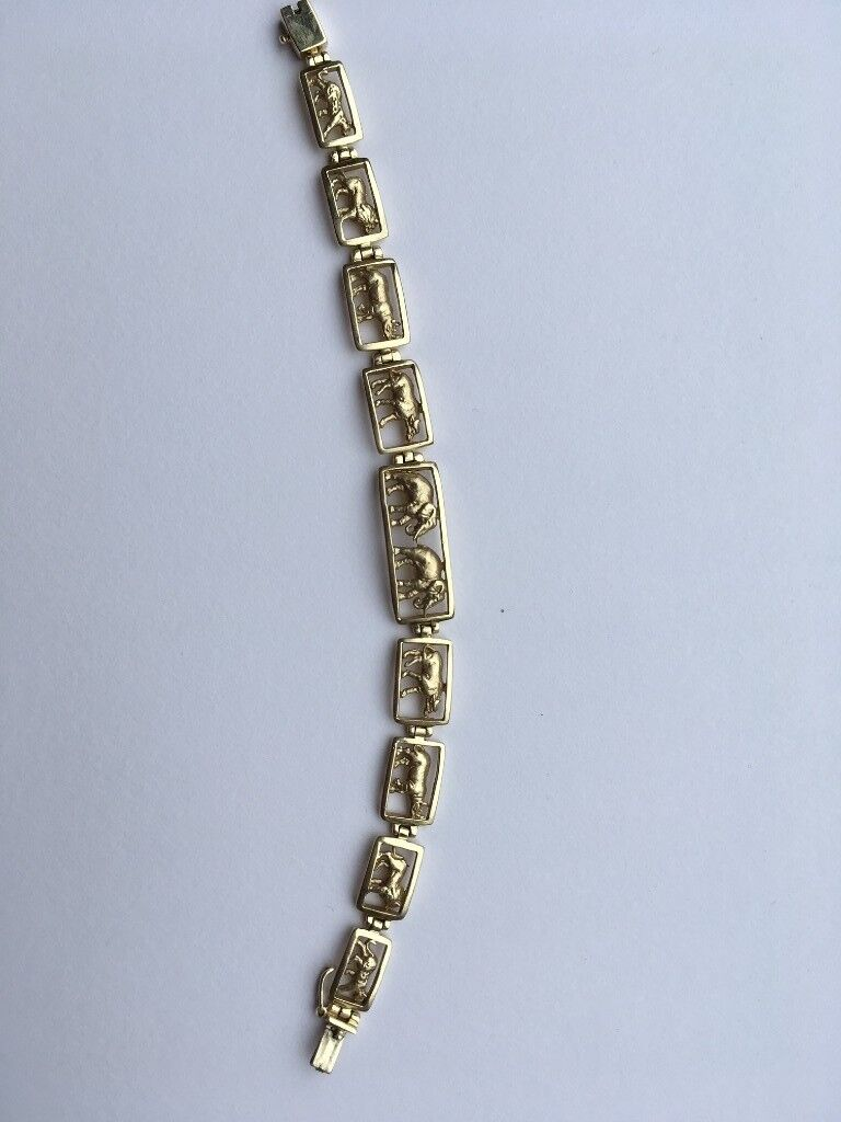 14ct gold bracelet from South Africa displaying big five game  | in  Macclesfield, Cheshire | Gumtree