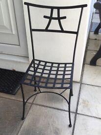 4 matching black metal chairs