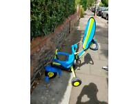 Children's tricycle with handle